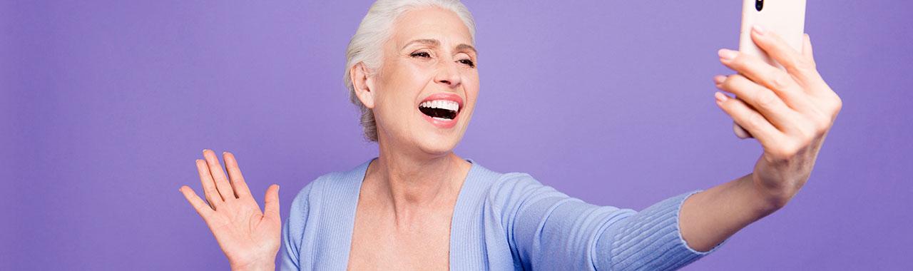 Elderly woman taking a selfie
