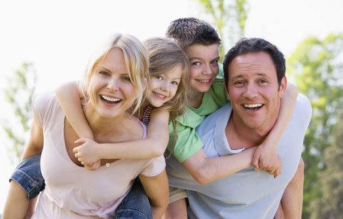Family of four having fun outdoors